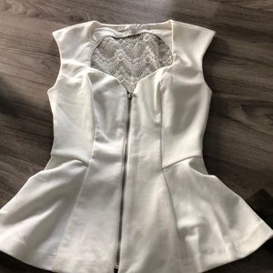 Guess brand peplum top in ivory